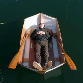Relax in a woodenwidget dinghy